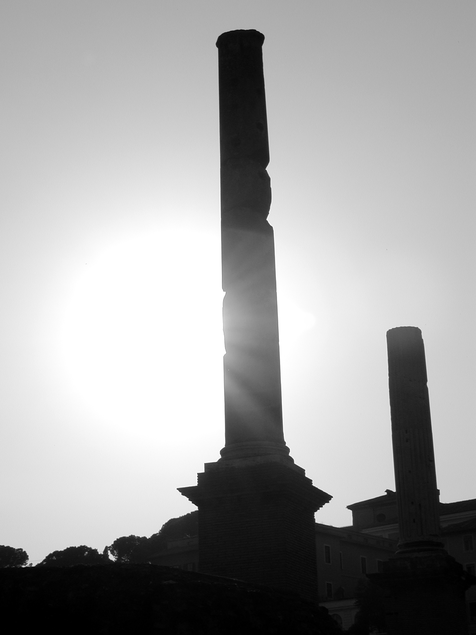 Silhouetted Roman ruins.