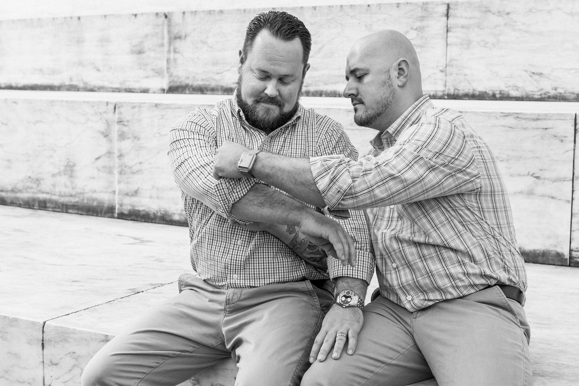 DC Same Sex Engagement Shoot at the Jefferson Memorial in Washington, DC - Two guys adjusting shirts.