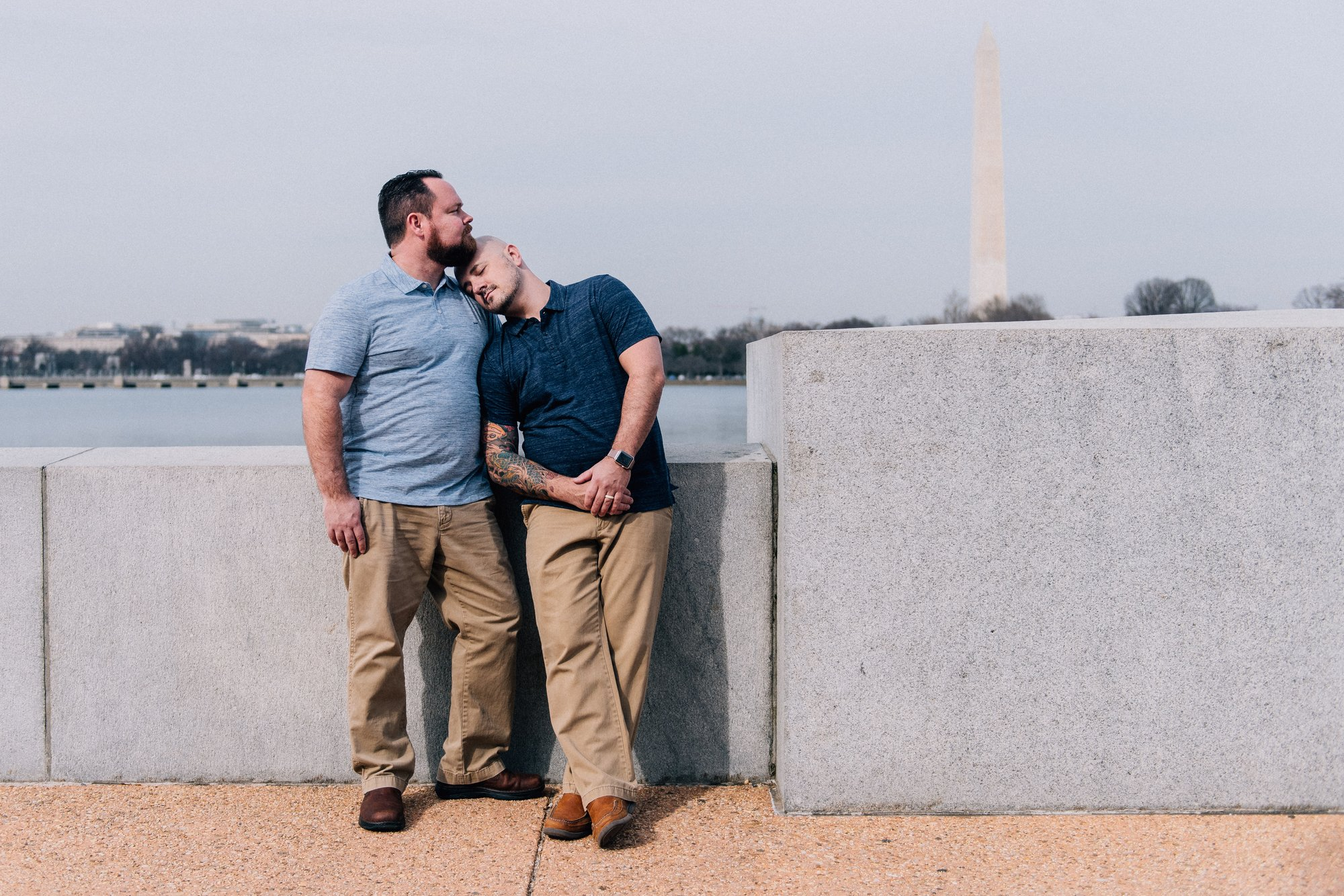 Washington, DC Same Sex Engagement Shoot at the Jefferson Memorial with the Tidal Basin and Washingon Monument in the background.