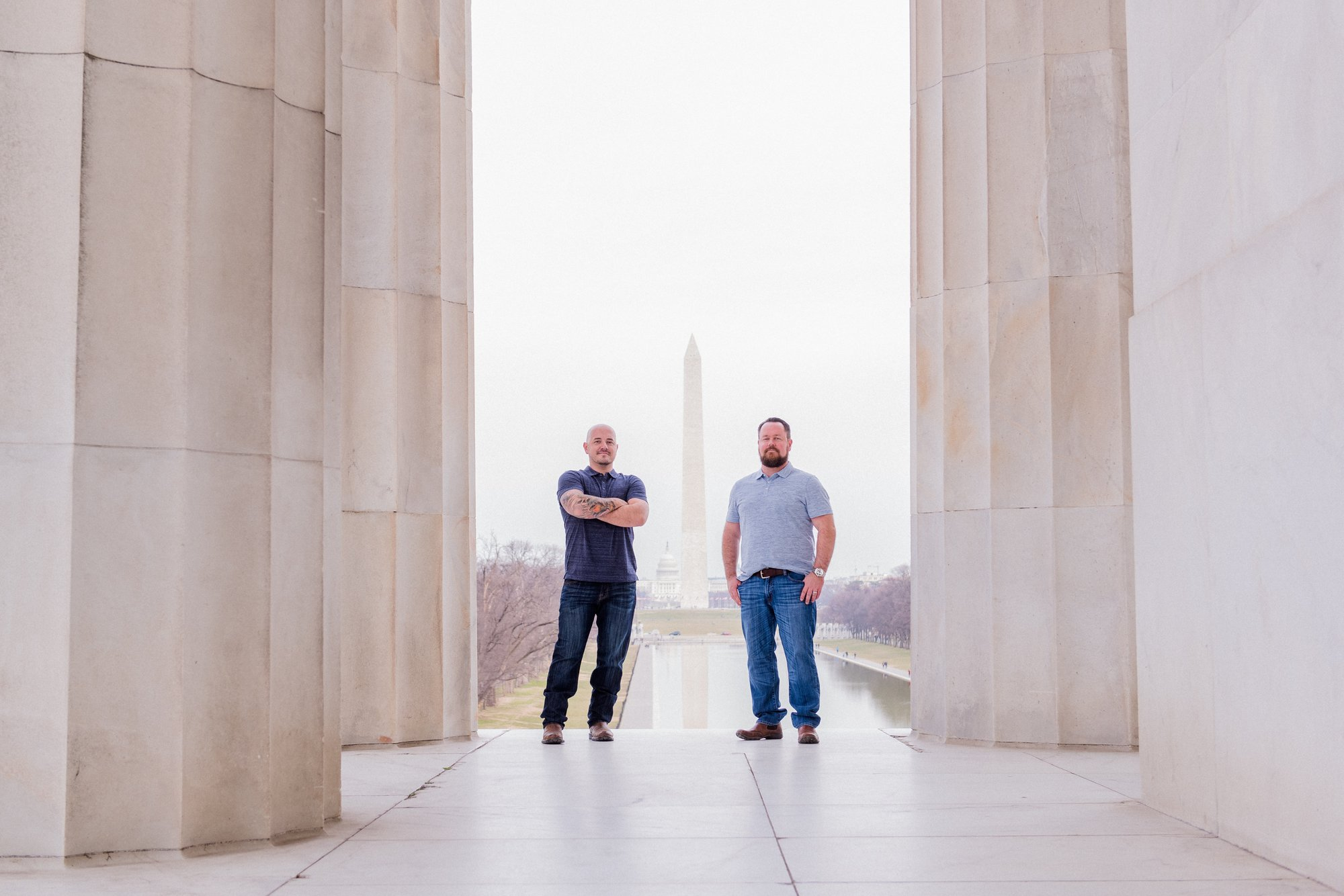 Washington, DC Same Sex Engagement Shoot at the Lincoln Memorial with the Washington Monument in the background.