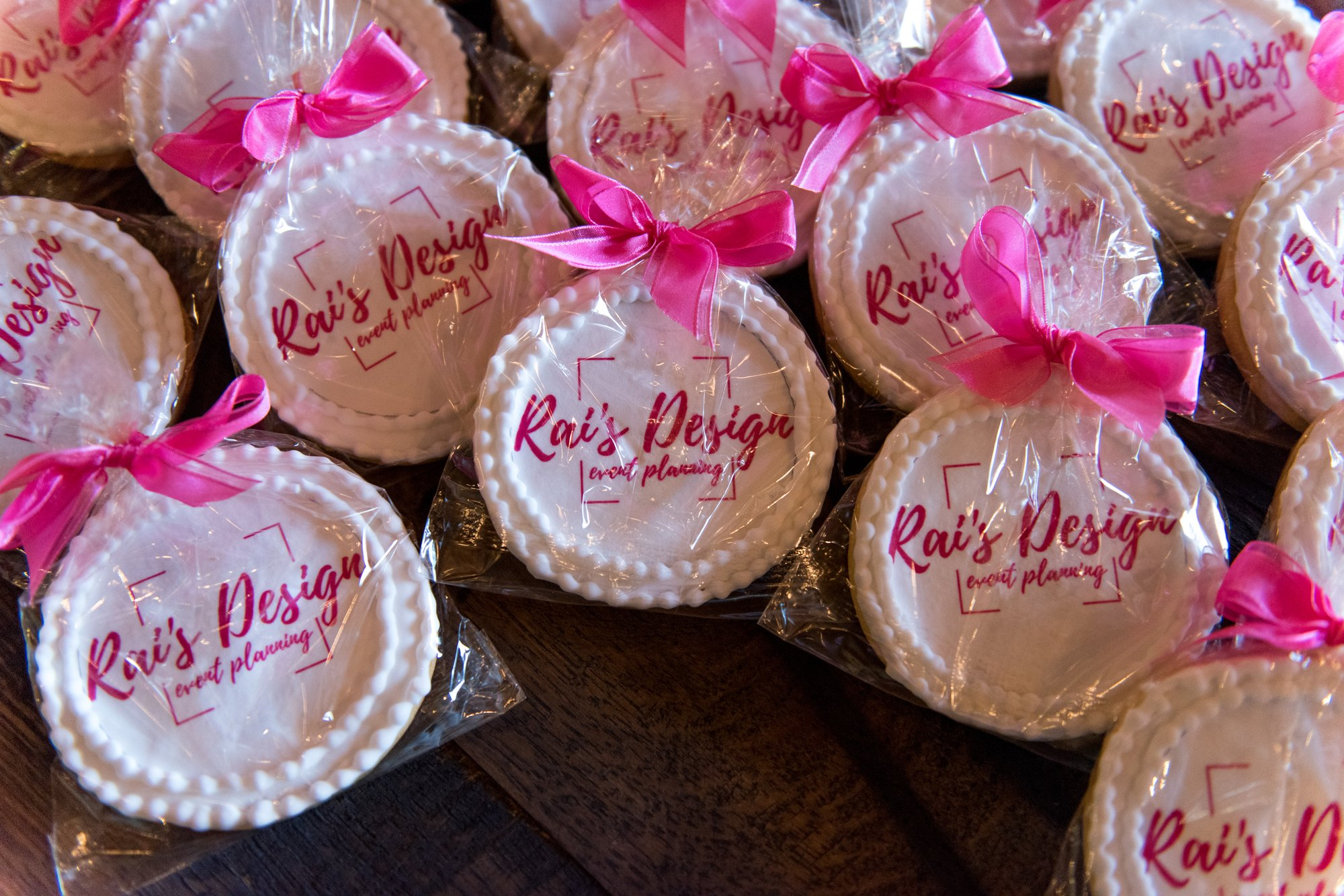 Cookies from Rai's Design and Event Planning, Coordination and Styling, with pink ribbons.