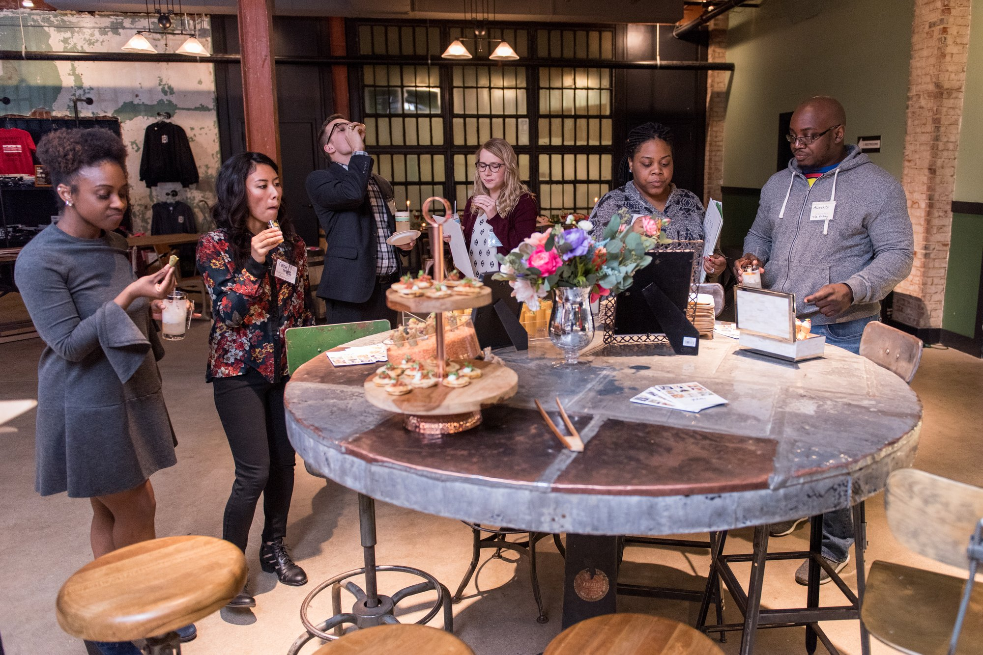 Vendors and guests from the District Bliss Couples Social at One Eight Distilling in Ivy City, Washington, DC