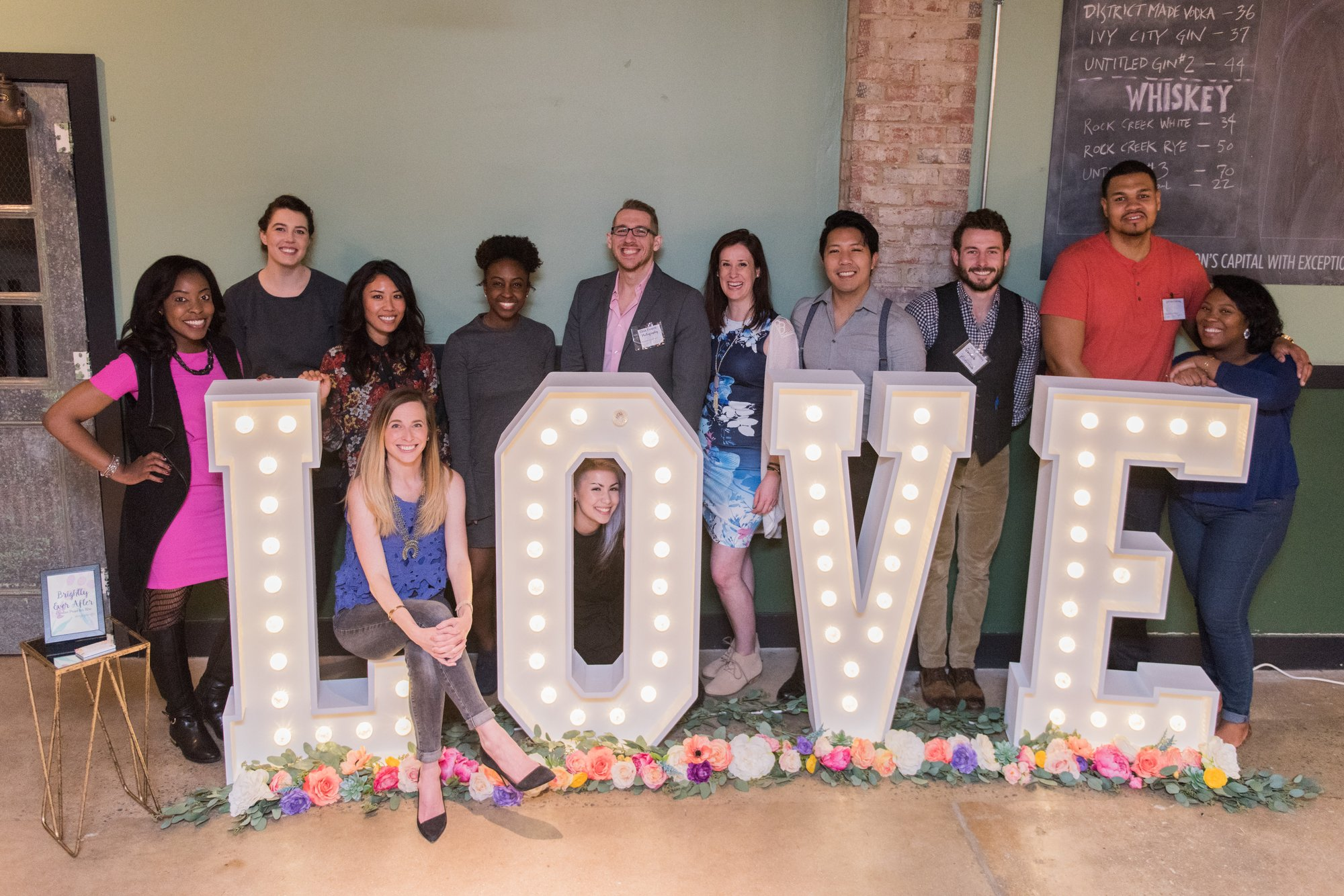 The entire team of vendors from the District Bliss Couples Social at One Eight Distilling in Ivy City, Washington, DC